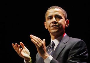 U.S.DemocraticpresidentialcandidateSenatorBarackObama(D-IL)applaudsattheendofhisspeechattheVirginiaDemocraticPartyJeffersonJacksondinnerinRichmond,VirginiaFeb.9,2008.(Xinhua/ReutersFilePhoto)