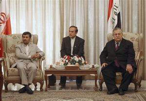 Iranian President Mahmoud Ahmadinejad, left, and his Iraqi counterpart Jalal, Talabani, right, sit as their ministers sign bilateral agreements in Baghdad, Iraq, Monday, March 3, 2008. (AP Photo/Hadi Mizban)