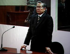 The video grab image taken on Dec. 11, 2007 shows former Peruvian President Alberto Fujimori waiting to be sentenced in Lima, capital of Peru. A Peruvian court sentenced Alberto Fujimori to six years in prison for abuse of power and ordered him to pay a fine of 400,000 new soles (around 132,000 U.S. dollars) to the state. (Xinhua File Photo)