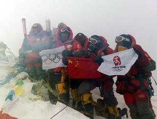 Chinese climbers display an Olympic torch, an Olympic flame lantern, a flag of International Olympic Committee, a Chinese National flag and a flag of the 29th Olympic Games at the top of the 8844.43-meter summit of Mt. Qomolangma in southwest China's Tibet Autonomous Region on May 8, 2008.