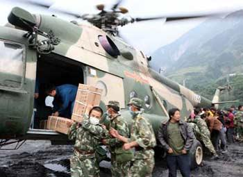 Rescuers unload medical materials from a helicopter in Yingxiu Town of Wenchuan County, the epicenter of Monday's massive earthquake on May 14, 2008.(Xinhua Photo)