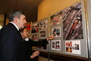 Chinese Ambassadress to Britain Fu Ying (R) shows photos about earthquake in China to British Prime Minister Gordon Brown at the Chinese Embassy in London, capital of Britain, May 20, 2008. Brown came to the Chinese Embassy on May 20 to offer condolences to Chinese quake victims. (Xinhua Photo)