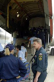 Members of Russian medical team unload relief materials from a chartered plane carrying a Russian medical team in Chengdu, capital of the quake-hit Sichuan province, May 20, 2008. Along with the team arrived a mobile hospital, vehicles and relief materials. Another 36-tonnes of humanitarian assistance materials from Russia will arrive in the city on Tuesday afternoon including medicines weighing 7 tonnes. (Xinhua Photo)