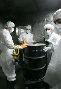 Iranian technicians remove a container of radioactive material from the Uranium Conversion Facilities in Isfahan, Iran, in 2005.(AFP/File/Behrouz Mehri)