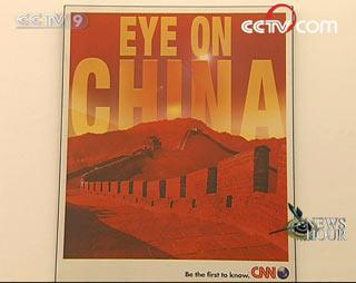 A poster in the headquarter of CNN reflects foreign media's interests in China. (CCTV.com)
