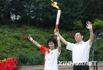 The Olympic torch is carrying through Leshan, Sichuan province.