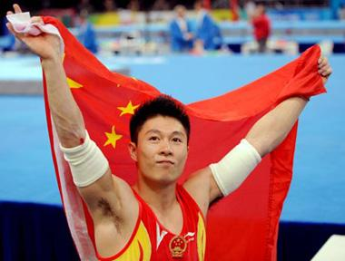 Li Xiaopeng of China celebrates after claiming gold of men's parallel bars final of Beijing 2008 Olympic Games at National Indoor Stadium in Beijing, China, Aug. 19, 2008. (Xinhua Photo)