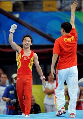 China's Zou Kai celebrates after his performance in men's horizontal bar final of Beijing 2008 Olympic Games at National Indoor Stadium in Beijing, China, Aug. 19, 2008. Zou Kai claimed the title of the event with a score of 16.200. (Xinhua Photo)