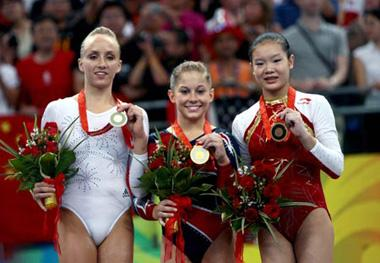 Gold medalist Shawn Johnson (C) of the United States, silver medalist Nastia Liukin (L) of the United States, and China's bronze winner Cheng Fei celebrate during the awarding ceremony for women's balance beam final of Beijing 2008 Olympic Games at National Indoor Stadium in Beijing, China, Aug. 19, 2008. (Xinhua Photo)