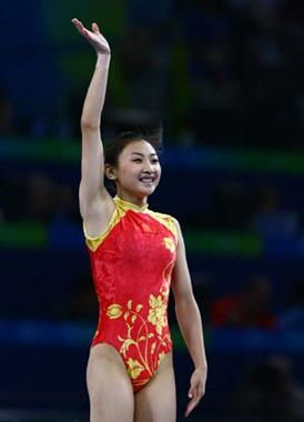 China's He Wenna gestures after her performance during trampoline women's final of Beijing 2008 Olympic Games at National Indoor Stadium in Beijing, China, Aug. 18, 2008. He claimed the title of the event with a score of 37.80. (Xinhua Photo)