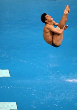 He Chong of China performs a dive during the Men's 3m Springboard Final of Beijing 2008 Olympic Games diving event in Beijing, China, Aug. 19, 2008. He Chong claimed gold of the event with a total score of 572.90 points. (Xinhua/Liu Yu)