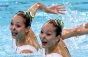 Tearful Chinese synchro swimming twins fail to dance to podium