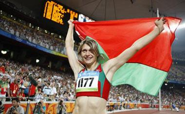 Aksana Miankova of Belarus celebrates after the women's hammer throw final at the National Stadium, also known as the Bird's Nest, during Beijing 2008 Olympic Games in Beijing, China, Aug. 20, 2008. Aksana Miankova won the gold with 76.34 metres and set a new Olympic record.(Xinhua Photo)