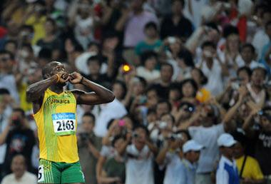 Usain Bolt of Jamaica celebrates after the men's 200m final at the National Stadium, also known as the Bird's Nest, during Beijing 2008 Olympic Games in Beijing, China, Aug. 20, 2008. Usain Bolt of Jamaica won the title with 19.30 seconds and set a new world record. (Xinhua/Guo Dayue)