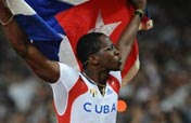 Robles claims Olympic men´s 110m hurdles title with ease