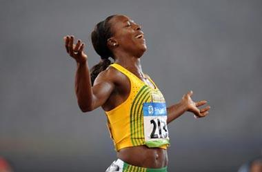 Veronica Campbell-Brown of Jamaica jubilates after winning the women's 200m final at the National Stadium, also known as the Bird's Nest, during Beijing 2008 Olympic Games in Beijing, China, Aug. 21, 2008. (Xinhua Photo)
