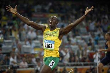 Usain Bolt of Jamaica jubilates after the men's 200m final at the National Stadium, also known as the Bird's Nest, during Beijing 2008 Olympic Games in Beijing, China, Aug. 20, 2008. Usain Bolt of Jamaica won the title with 19.30 seconds and set a new world record. (Xinhua/Guo Dayue)