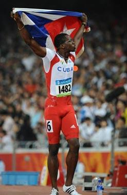 Dayron Robles of Cuba celebrates after the men's 110m hurdles final at the National Stadium, also known as the Bird's Nest, during Beijing 2008 Olympic Games in Beijing, China, Aug. 21, 2008. Dayron Robles won the title.(Xinhua Photo)