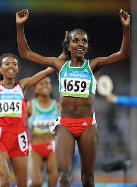 Tirunesh Dibaba of Ethiopia celebrates after the women's 5,000m final at the National Stadium, also known as the Bird's Nest, during Beijing 2008 Olympic Games in Beijing, China, Aug. 22, 2008. Tirunesh Dibab won the gold.(Xinhua/Guo Dayue)