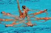 Russia takes double golds in synchronized swimming