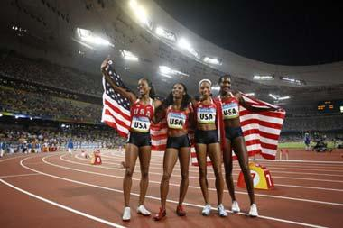 Runners of the United States celebrate after the women's 4x400m relay final at the National Stadium, also known as the Bird's Nest, during Beijing 2008 Olympic Games in Beijing, China, Aug. 23, 2008. The team of the United States won the title with 3:18.54.(Xinhua/Liao Yujie)