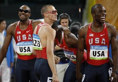 Runners of the United States react after the men's 4x400m relay final at the National Stadium, also known as the Bird's Nest, during Beijing 2008 Olympic Games in Beijing, China, Aug. 23, 2008. The team of the United States won the title with 2:55.39 and set a new Olympic record. (Xinhua/Liao Yujie)