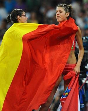 Tia Hellebaut (L) of Belgium celebrates with Blanka Vlasic of Croatia after the women's high jump final at the National Stadium, also known as the Bird's Nest, during Beijing 2008 Olympic Games in Beijing, China, Aug. 23, 2008. Tia Hellebaut won the title with 2.05 metres. Blanka Vlasic took the silver.(Xinhua Photo)