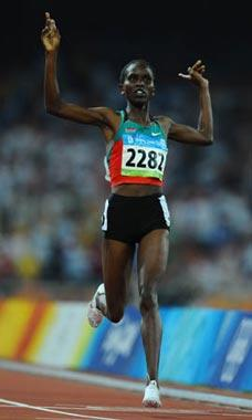 Nancy Jebet Langat of Kenya gestures as she crosses the finish line during the women's 1,500m final at the National Stadium, also known as the Bird's Nest, during Beijing 2008 Olympic Games in Beijing, China, Aug. 23, 2008. Nancy jebet Langat won the title with 4:00.23. (Xinhua/Guo Dayue)