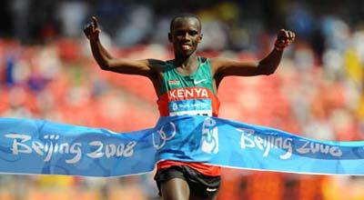 Kenya's Samuel Kamau Wansiru crosses the finish line during men's marathon final at the National Stadium, also known as the Bird's Nest, during Beijing 2008 Olympic Games in Beijing, China, Aug. 24, 2008. Samuel Kamau Wansiru won the title. (Xinhua Photo)