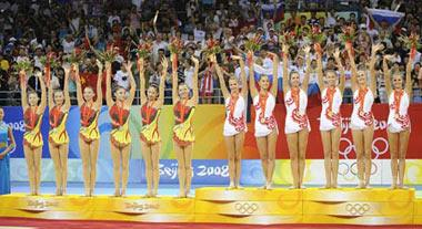 Gold medalists of Russia (R) and silver medalists of China stand on the podium at the awarding ceremony of the group all-around final of Beijing Olympic Games gymnastics rhythmic event in Beijing, China, Aug. 24, 2008.(Xinhua Photo)