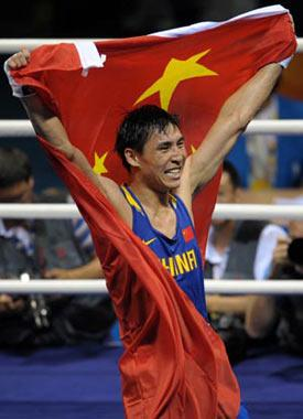 Zhang Xiaoping of China celebrates after defeating Kenny Egan of Ireland at the men's light heavy (81kg) final bout at Beijing 2008 Olympic Games boxing event at Worker's Gymnasium in Beijing, China, Aug. 24, 2008. Zhang Xiaoping won the gold medal of the event. (Xinhua Photo)