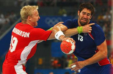 Ingimundur Ingimundarson of Iceland challenges Nikola Karabatic. (Photo credit: Vladimir Rys/Getty Images)