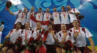 Players of Hungary pose for photos after winning men's water polo gold medal at the Beijing Olympic Games in Beijing, China, Aug. 24, 2008. (Xinhua/Wang Qingqin)