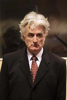 Former Bosnian Serb leader Radovan Karadzic attends a hearing at the United Nations tribunal in The Hague August 29, 2008. (Xinhua/AFP Photo)