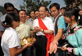 Chinese Premier Wen Jiabao visits Qiang ethnic group village in Beichuan County, southwest China's Sichuan Province, Sept. 1, 2008. Wen inspected repair work and raised morale among residents over the past three days, during a visit to southwestern Sichuan Province nearly four months after the devastating May 12 earthquake. (Xinhua Photo)
