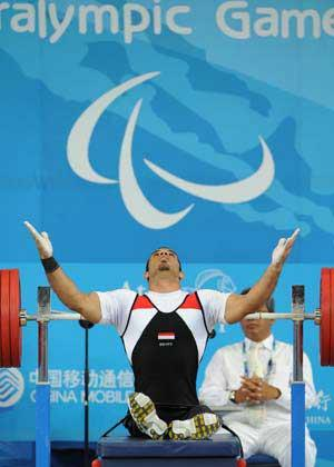 Sherif&nbsp;Othman&nbsp;Othman&nbsp;of&nbsp;Egypt&nbsp;reacts&nbsp;during&nbsp;the&nbsp;men's&nbsp;56kg&nbsp;final&nbsp;at&nbsp;the&nbsp;Beijing&nbsp;2008&nbsp;Paralympic&nbsp;Games&nbsp;Powerlifting&nbsp;event&nbsp;in&nbsp;Beijing,&nbsp;Sept.&nbsp;11,&nbsp;2008.&nbsp;Othman&nbsp;broke&nbsp;the&nbsp;world&nbsp;record&nbsp;and&nbsp;claimed&nbsp;the&nbsp;title&nbsp;with&nbsp;202.5kg.&nbsp;(Xinhua&nbsp;Photo)