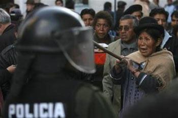 A supporter of Bolivia's President, Evo Morales, shouts slogans against Tarija's governor Mario Cossio as he arrives at the Government Palace in La Paz September 12, 2008. Violent anti-government protests have killed eight people in Bolivia, where rightist governors have rebelled against the popular president demanding autonomy and rejecting his plans to overhaul the constitution and break up ranches to give land to poor Indians.(Ivan Alvarado/Reuters)