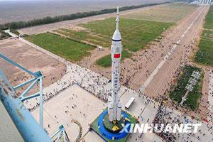 The Shenzhou-7 manned spaceship, the Long-March II-F rocket and the escape tower are vertically transferred to the launch pad at the Jiuquan Satellite Launch Center in northwest China's Gansu Province Sept. 20, 2008. The transfer finished at 3:15 p.m.on Saturday, marking the final stage of the launching preparation.(Xinhua Photo)