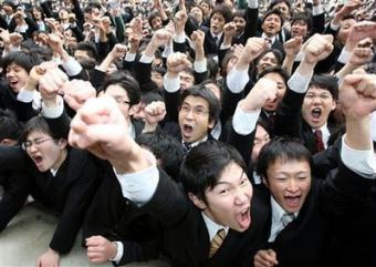 College students from vocational schools in Tokyo and Osaka, western Japan, give a shout during a joint pep ceremony to launch their job-hunting in Tokyo Thursday, Feb. 5, 2009. About 3,000 job seekers gathered for the annual event amid the global economic slump.(AP Photo/Koji Sasahara)
