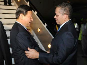 Chinese Vice President Xi Jinping (L) is greeted by Jamaican Prime Minister Bruce Golding upon his arrival in Kingston, capital of Jamaica, on Feb. 11, 2009. Jamaica is the second leg of Xi's six-nation tour, which has taken him to Mexico and will take him to Colombia, Venezuela, Brazil and Malta. (Xinhua/Huang Jingwen)