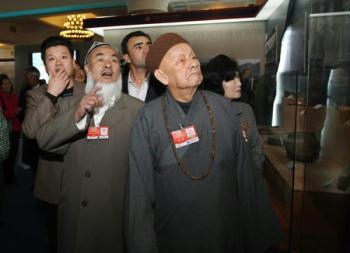 "Some members of the 11th National Committee of the Chinese People's Political Consultative Conference (CPPCC), who are attending the Second Session of the 11th National Committee of the CPPCC, visit an exhibition titled ""Democratic Reform in the Tibet Autonomous Region"" at the Cultural Palace of Nationalities in Beijing, capital of China, March 11, 2009. (Xinhua/Liu Weibing)"