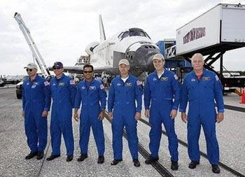 L-R: US space shuttle Discovery commander Lee Archambault, pilot Tony Antonelli, mission specialists Joseph Acaba, Steve Swanson, Richard Arnold and John Phillips after Discovery landed at Kennedy Space Center in Florida. The space shuttle Discovery and its crew of seven safely landed in Florida after completing its mission to install solar arrays aboard the orbiting International Space Station.(AFP/POOL/Terry Renna)