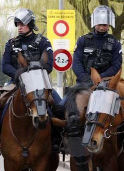 'French riot policemen on Horses stand guard next to the