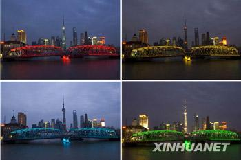 The newly restored Waibaidu Bridge, sitting over the Suzhou river at the Bund area in central Shanghai, turns on colorful LED lights on the night of April 2, 2009, testing its new lighting system called 'City Lights'. The 102-year-old bridge will re-open to traffic on April 10. [Photo:Xinhuanet]