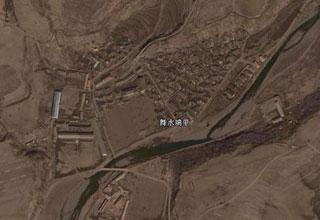 The undated satellite photo provided by Google Earth shows the Musudan-ri missile base in the Democratic People's Republic of Korea (DPRK). The DPRK on Sunday launched communications satellite by Kwangmyongsong-2 rocket at local time 11:32 (02:32 GMT Sunday), South Korea's Yonhap News Agency reported, by quoting Japan's NHK, Sunday. (Xinhua Photo)