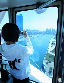 'A tourist takes pictures from a cabin on the 120-meter-high observation wheel