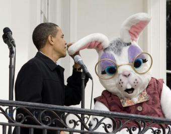 U.S. President Barack Obama talks into the Easter Bunny's ear as a joke after both microphones did not work while on the balcony of the White House before the start of the 2009 Easter Egg Roll on the South Lawn in Washington April 13, 2009.  (Xinhua/Reuters Photos)