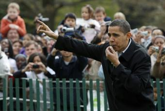 U.S. President Barack Obama blows a whistle to start the Annual Easter Egg Roll on the South Lawn at the White House in Washington April 13, 2009.(Xinhua/Reuters Photos)