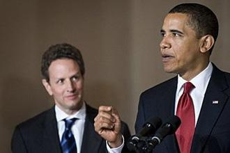 US President Barack Obama and US Treasury Secretary Timothy Geithner (L) deliver remarks on US tax reform in the Grand Foyer of the White House in Washington, DC.  (AFP/Jim Watson)