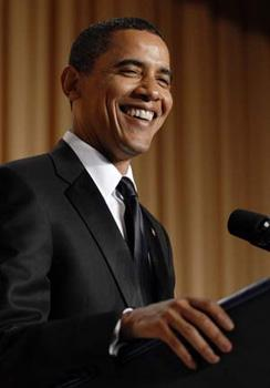 U.S. President Barack Obama laughs during his comic monologue during the White House Correspondents' Association Dinner in Washington May 9, 2009.(Xinhua/Reuters Photo)